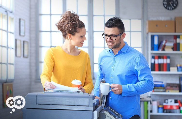 Forget the water cooler...everyone these days is gossiping around the digital copier instead.